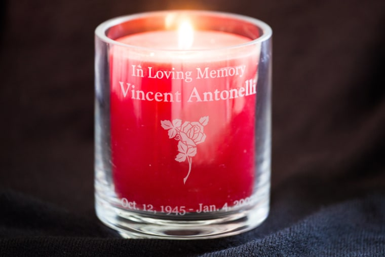 votive-candle-with-rose-dark-background