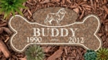 Dog Bone 2 Pet Memorial on lawn in Desert Pink PM116CR on woodchips